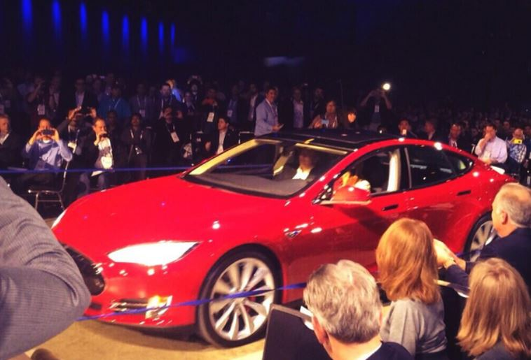 Elon Musk arrived at the Dell World stage in a Tesla automobile